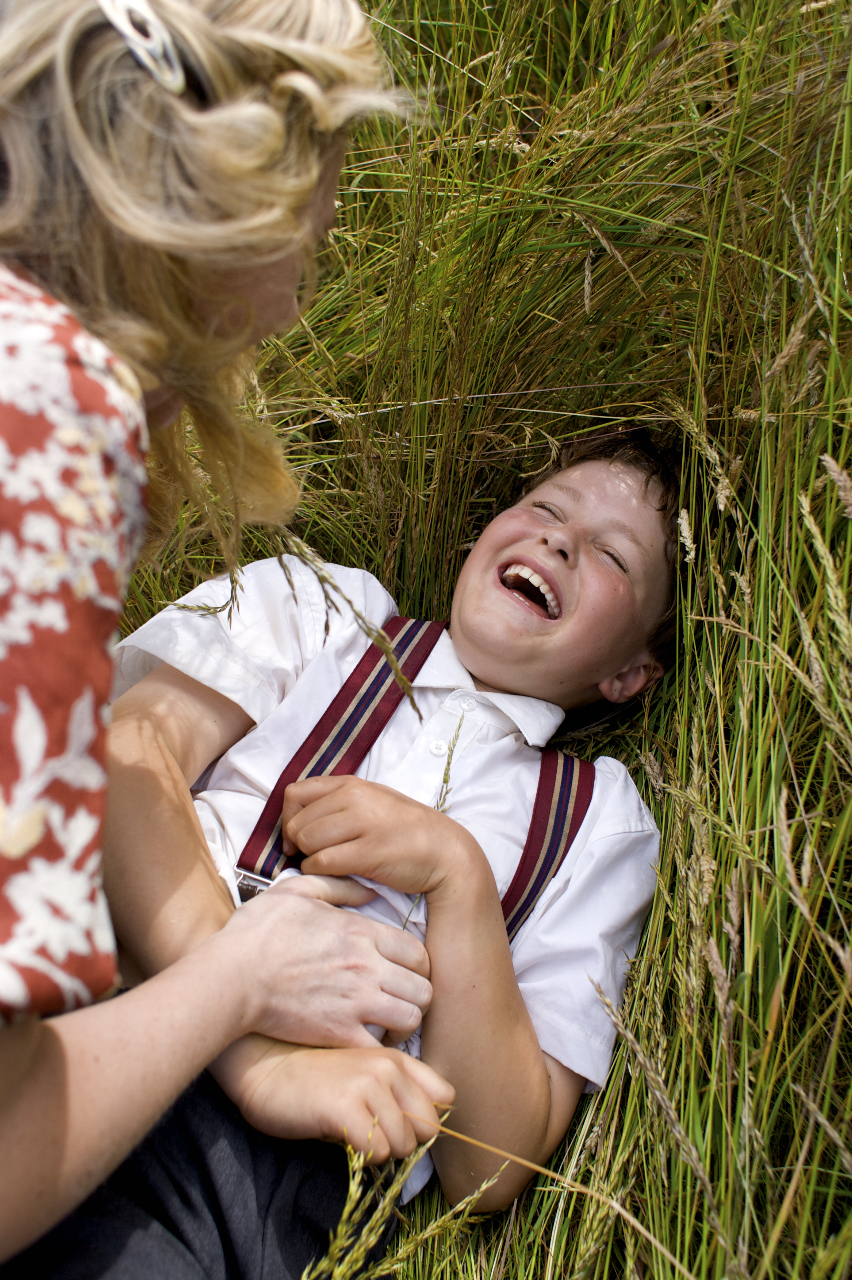 Albert as a child being tickled
